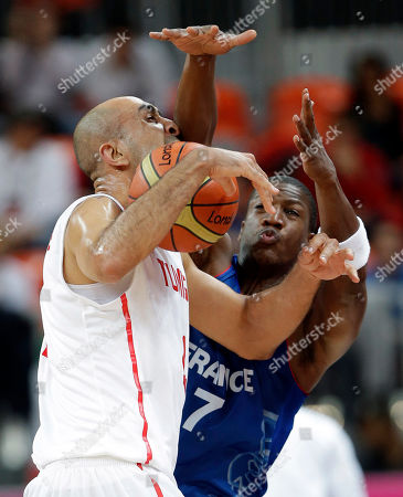 Radhouane Slimane,Yakhouba Diawara Tunisia's Radhouane Slimane, left, is pressured by France's Yakhouba Diawara, right, during a preliminary men's basketball game at the 2012 Summer Olympics, in London