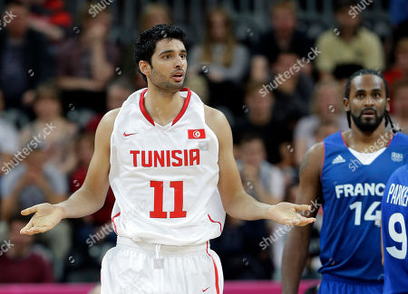 Mokhtar Ghayaza, Ronny Turiaf Tunisia's Mokhtar Ghayaza (11) questions a call as France's Ronny Turiaf looks on during a preliminary men's basketball game at the 2012 Summer Olympics, in London