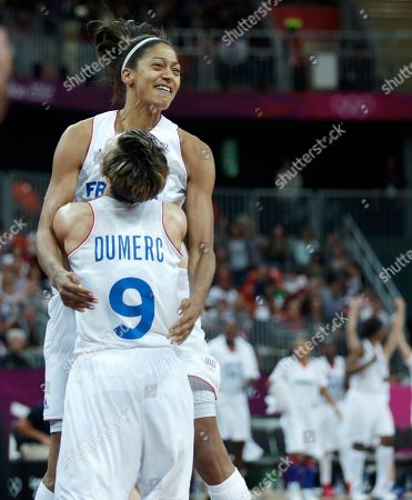 Emmeline Ndongue, Celine Dumerc France's Emmeline Ndongue smiles as she embraces teammate Celine Dumerc after their overtime win during a women's basketball game against Australia at the 2012 Summer Olympics, in London