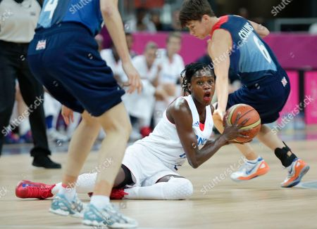Emilie Gomis, Stef Collins, Natalie Stafford France's Emilie Gomis looks to pass as she is flanked by Britain's Stef Collins, right, and Natalie Stafford during a women's basketball game at the 2012 Summer Olympics, in London
