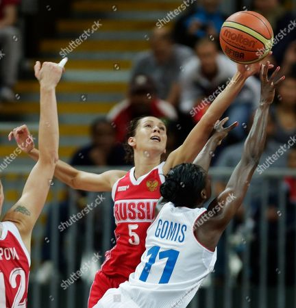Endene Miyem, Emilie Gomis Russia's Endene Miyem (5) blocks France's Emilie Gomis on a drive to the basket during a women's basketball game at the 2012 Summer Olympics, in London