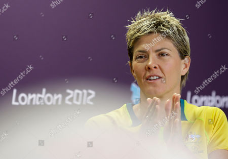 Stock Picture of Five-time Olympian Natalie Cook from Australia gestures during a press conference at the 2012 Summer Olympics, in London. The beach volleyballer was eliminated on Wednesday