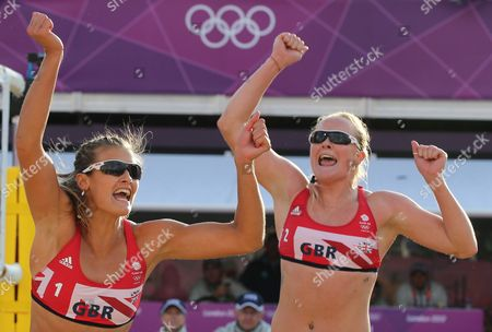 Zara Dampney, left, from Great Britain celebrates with her teammate Shauna Mullin, right, after defeating Canada in their Beach Volleyball match at the 2012 Summer Olympics, in London