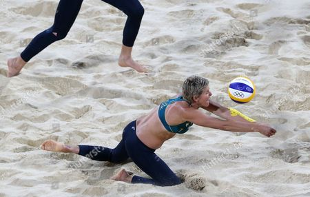 Natalie Cook from Australia dives for a ball during the Beach Volleyball match against Austria at the 2012 Summer Olympics, in London