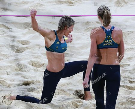 Natalie Cook, left, and Tamsin Hinchley, right, from Australia react during their Beach Volleyball match against Austria at the 2012 Summer Olympics, in London