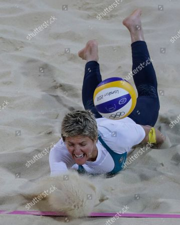 Australia's Natalie Cook dives for the ball during a beach volleyball match against the United States at the 2012 Summer Olympics, in London
