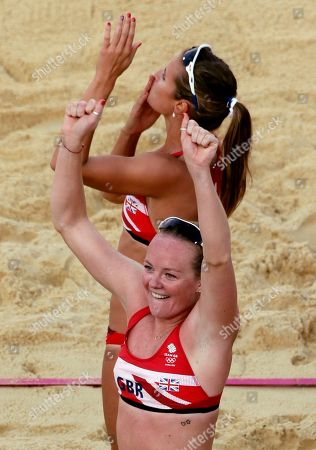 Great Britain's Shauna Mullin, front, and Zara Dampney thank the crowd after they beat Canada during a beach volleyball match at the 2012 Summer Olympics, in London