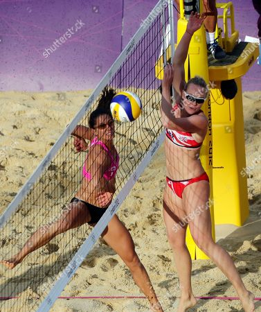 Great Britain's Shauna Mullin, right, battles Canada's Annie Martin during a beach volleyball match at the 2012 Summer Olympics, in London