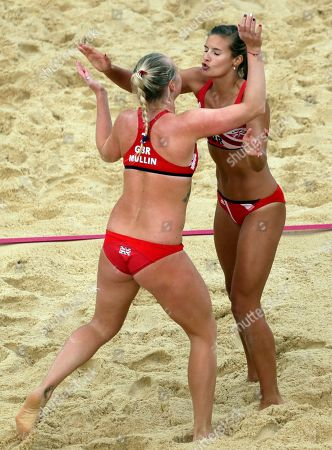 Great Britain's Shauna Mullin, left, and Zara Dampney embrace after they beat Canada during a beach volleyball match at the 2012 Summer Olympics, in London
