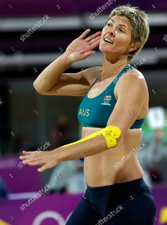 Stock Image of Natalie Cook of Australia get the crowd to react in the first set of a game against Austria during a beach volleyball match at the 2012 Summer Olympics, in London