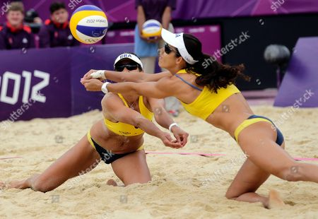 Brazil's Maria Antonelli, left, and Shauna Mullin go for the ball in the first set of a three-set win over Germany during a beach volleyball match at the 2012 Summer Olympics, in London