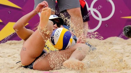 Shauna Mullin of Brazil dives for a ball during a beach volleyball match against Germany at the 2012 Summer Olympics, in London