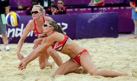 Great Britain's Shauna Mullin, left, and Zara Dampney go for a ball during a beach volleyball match against Italy at the 2012 Summer Olympics, in London