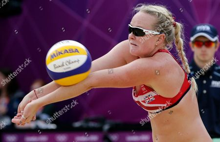 Great Britain's Shauna Mullin plays a ball during a beach volleyball match against Italy at the 2012 Summer Olympics, in London