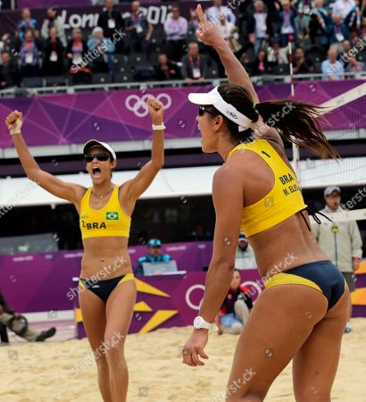 Brazil's Maria Antonelli, right, Shauna Mullin react after a three-set win over Germany during a beach volleyball match at the 2012 Summer Olympics, in London