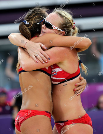 Great Britain's Shauna Mullin, right, and Zara Dampney embrace during a loss to Italy during a beach volleyball match against Italy at the 2012 Summer Olympics, in London