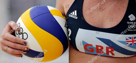 Stock Image of Shauna Mullin of England holds a volleyball as she prepares to serve to Russia in a beach volleyball match at the 2012 Summer Olympics, in London