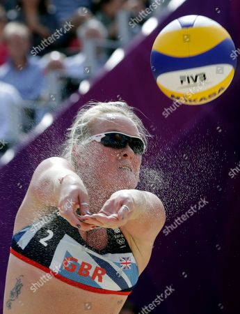 Shauna Mullin of Great Britain returns the ball during a beach volleyball match against Russia at the 2012 Summer Olympics, in London