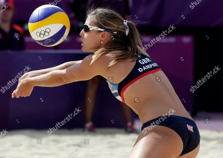 Zara Dampney of Great Britain hits the ball during a beach volleyball match against the Russia at the 2012 Summer Olympics, in London