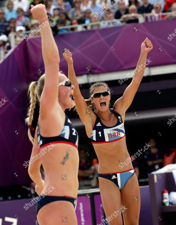 Zara Dampney, right, and Shauna Mullin of Great Britain react after making a point during a beach volleyball match against Russia at the 2012 Summer Olympics, in London