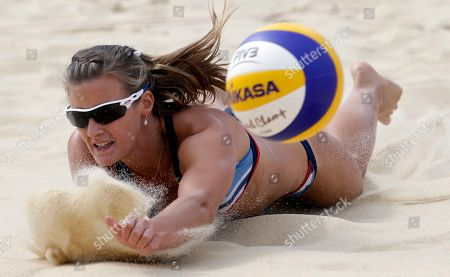Zara Dampney of Great Britain tries to make a dig during a beach volleyball match against Russia at the 2012 Summer Olympics, in London