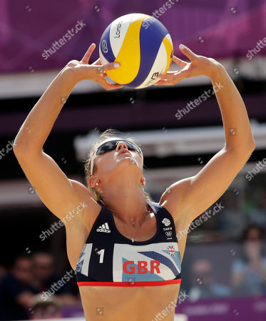 Zara Dampney of Great Britain sets the ball during a beach volleyball match against Russia the 2012 Summer Olympics, in London