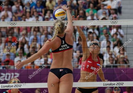 Stock Picture of Shauna Mullin of Great Britain spikes the ball over Evgenia Ukolova of Russia during a beach volleyball match at the 2012 Summer Olympics, in London