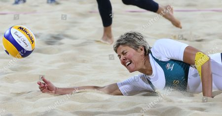 Natalie Cook from Australia dives for a ball during the Beach Volleyball match against USA at the 2012 Summer Olympics, in London