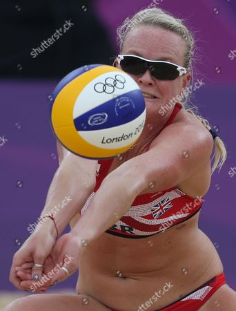 Shauna Mullin from Great Britain plays a ball during the Beach Volleyball match against Italy at the 2012 Summer Olympics, in London