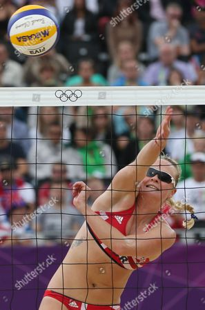 Shauna Mullin from Great Britain spikes a ball during the Beach Volleyball match against Italy at the 2012 Summer Olympics, in London