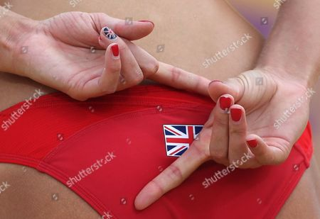 Zara Dampney from Great Britain signals to her teammate during the Beach Volleyball match against Italy at the 2012 Summer Olympics, in London
