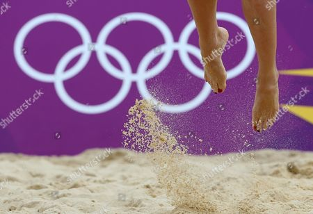 Shauna Mullin from Great Britain leaps for a serve during the Beach Volleyball match against Italy at the 2012 Summer Olympics, in London