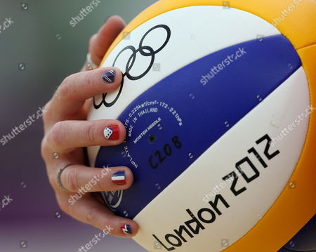 Stock Photo of Shauna Mullin from Great Britain holds a ball during the Beach Volleyball match against Italy at the 2012 Summer Olympics, in London