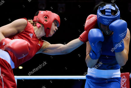 Sweden's Anna Laurell, left, fights Australia's Naomi-Lee Fisher-Rasmussen, during the women's 75-kg middleweight boxing competition at the 2012 Summer Olympics, in London