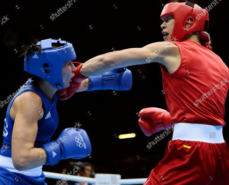 Sweden's Anna Laurell, right, punches fights Australia's Naomi-Lee Fisher-Rasmussen, fight during the women's 75-kg middleweight boxing competition at the 2012 Summer Olympics, in London
