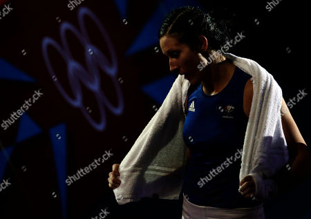 Naomi-Lee Fischer-Rasmussen, Anna Laurell Australia's Naomi-Lee Fisher-Rasmussen, leaves the arena after her fight against Sweden's Anna Laurell, during the women's 75-kg middleweight boxing competition at the 2012 Summer Olympics, in London