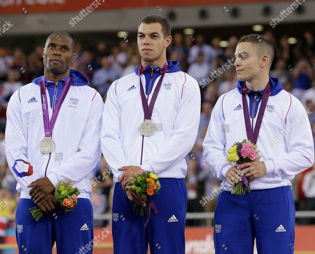Gregory Bauge, Kevin Sireau, Michael D'Almeida Gregory Bauge, left, Kevin Sireau, center, and Michael D'Almeida, right, react on the podium after winning the silver medal in the men's team sprint track cycling event in the velodrome during the 2012 Summer Olympics, in London