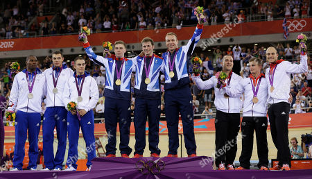 Chris Hoy, Jason Kenny, Philip Hindes, Gregory Bauge, Kevin Sireau, Michael D'Almeida, Robert Forstemann, Rene Enders, Maximilian Levy The British track cycling men's team sprint team, Chris Hoy, fourth from right, Jason Kenny, center, and Philip Hindes, fourth from left, celebrate on the podium after winnig the gold medal flanked by silver medals winners, of France, Gregory Bauge, left, Kevin Sireau, second from left, and Michael D'Almeida, third from left and German Bronze medalists Robert Forstemann, third from right, Rene Enders, second from right, and Maximilian Levy, right, during the 2012 Summer Olympics, in London