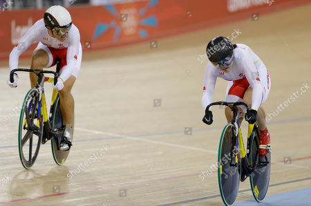 Gong Jinjie, Guo Shang China's Gong Jinjie, left, and Guo Shang pedal on their way to set anew world record during a track cycling women's team sprint heat, at the velodrome during the 2012 Summer Olympics, in London. The Chinese posted a time of 32.447 seconds over the two laps at the velodrome after Victoria Pendleton and Jessica Varnish of Britain finished in 32.526 seconds