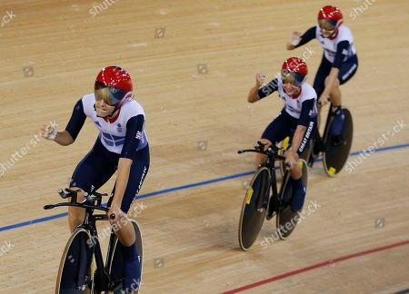 Stock Image of Dani King, Joanna Roswell, Laura Trott Britain's Dani King, left, Joanna Roswell, right, and Laura Trott, above, celebrate after they set a world record during a track cycling women's team pursuit event, during the 2012 Summer Olympics, in London. TThe British team posted a time of 3 minutes, 15.669 seconds to break the mark of 3:15.720 they set at the world championships in April. It was the seventh world record to fall during the first two days of track cycling at the London Games