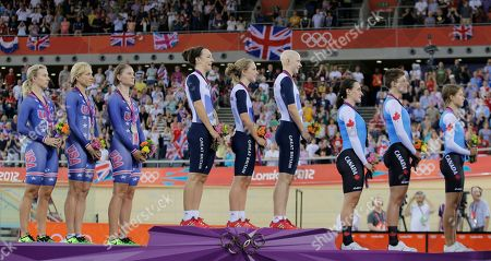 Dani King, fourth from left, Laura Trott, center, Joanna Rowsell, Tara Whitten, Gillian Carleton, Jasmin Glaesser, Jennie Reed, Dotsie Bausch, Sarah Hammer Britain's Dani King, fourth from left, Laura Trott, center, and Joanna Rowsell, fourth from right, look towards their flag during the medal ceremony for their gold medal in the track cycling women's pursuit team event as the team from the United States, left, took the silver medal and the Canadian team, right, the bronze at the 2012 Summer Olympics in London, . The British women's pursuit track cycling team shattered its own world record for the second time Saturday and beat the United States to win the Olympic gold medal