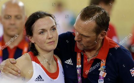 Victoria Pendleton Britain's Victoria Pendleton is comforted by a team staffer after her and teammate Jessica Varnish and saw their medal hopes vanish when they were relegated for making an early change in the first round of a track cycling women's team sprint event, during the 2012 Summer Olympics, in London