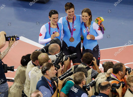 Tara Whitten, Gillian Carleton, Jasmin Glaesser From left, Canada's Tara Whitten, Gillian Carleton and Jasmin Glaesser celebrate the bronze medal they won in the track cycling women's team pursuit, during the 2012 Summer Olympics in London
