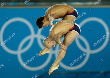 Thomas Daley, rear, and Peter Waterfield, front, from Great Britain compete during the Men's Synchronized 10 Meter Platform Diving final at the Aquatics Centre in the Olympic Park during the 2012 Summer Olympics in London