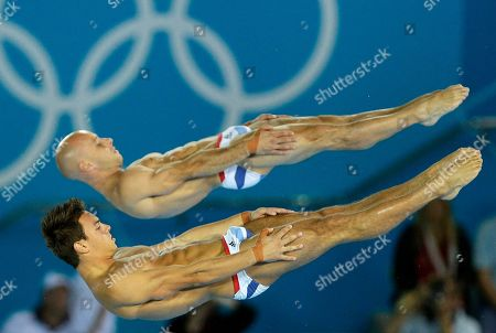 Thomas Daley, front, and Peter Waterfield, rear, from Great Britain compete during the Men's Synchronized 10 Meter Platform Diving final at the Aquatics Centre in the Olympic Park during the 2012 Summer Olympics in London