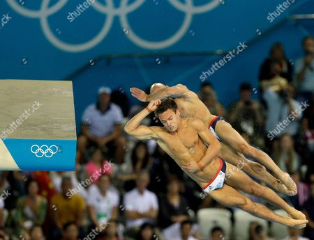 Thomas Daley, front, and Peter Waterfield, right, from Great Britain compete during the Men's Synchronized 10 Meter Platform Diving final at the Aquatics Centre in the Olympic Park during the 2012 Summer Olympics in London