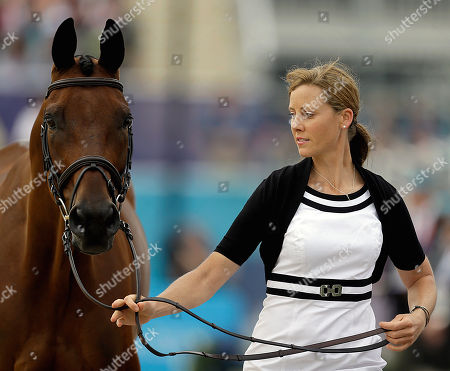 Rebecca Howard Canada's Rebecca Howard and her horse Riddle Master run during a horse inspection for the equestrian eventing competition at the 2012 Summer Olympics, in London