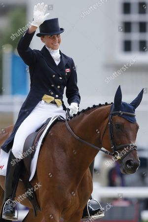 Rebecca Howard Rebecca Howard of Canada reacts after she competes with her horse Riddle Master in the equestrian eventing dressage phase at Greenwich Park, at the 2012 Summer Olympics, in London