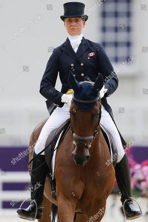 Rebecca Howard Rebecca Howard of Canada competes with her horse Riddle Master in the equestrian eventing dressage phase at Greenwich Park, at the 2012 Summer Olympics, in London