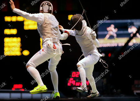 South Korea's Nam Hyun-hee faces USA's Lee Kiefer during a quarterfinals match at women's team foil fencing at the 2012 Summer Olympics, in London